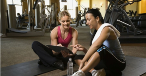 Trainer working with client to develop a custom fitness plan