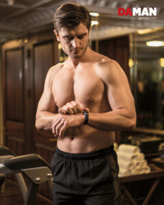 A man utilizing the capabilities of his fitness wearable.