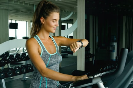 Woman using optimized smartwatch at Mississauga gym
